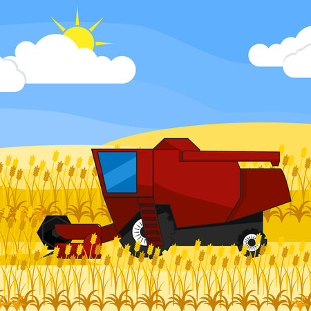 reaping: red harvester in the field collects ripe wheat