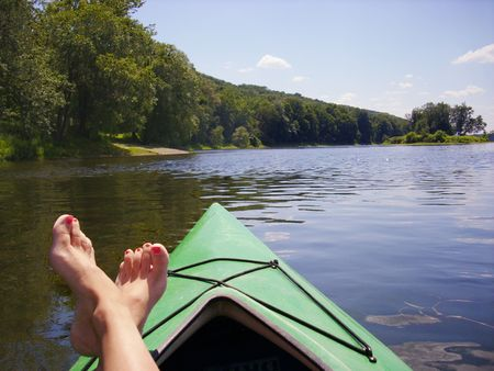 fun and relaxing trip down Delaware River with feet up on canoe   photo