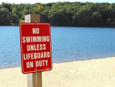 peril: no swimming unless lifeguard on duty sign on beach