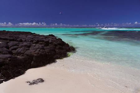 black stones formed by solidified lava on a beach on volcani? island of Mauritius, Indian ocean Stock Photo