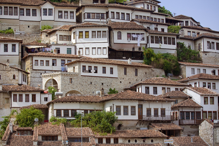 June 2014 - walls and windows of medieval houses built on a hillside in town Berat, Albania, inscribed on the UNESCO World Heritage List