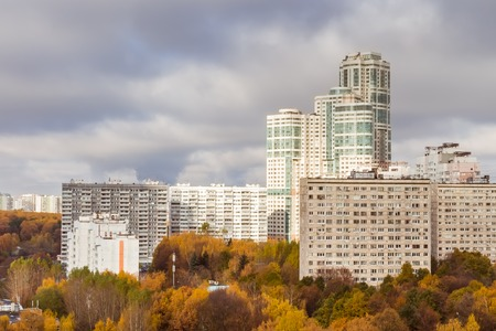 October 2017, Moscow, Russia - aerial view of modern high rise residential buildings surrounded by autumn pak