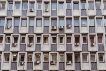 Air conditioners mounted on a wall of a soviet era office building in Moscow, Russia