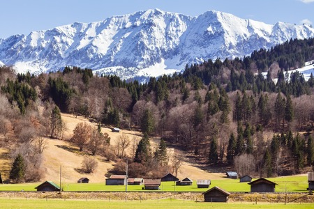 Farm houses with magnificent mountains in background