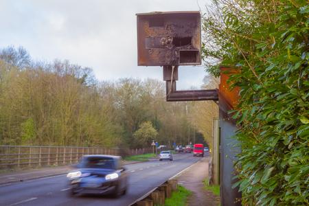 A burnt speed camera on a road in the UK Reklamní fotografie