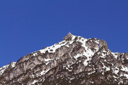 snow covered mountain peaks under blue sky