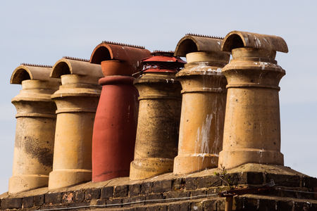 old chimneys of a roof of an old house in the UK
