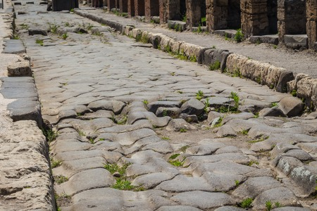 old road in the ruins of the Roman city of Pompei destroyed by Vesuvius vulcano eruption in 79 AD