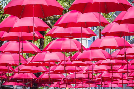umbrellas create shade on the street in Caudan Waterfront, main shopping district of the capital city Reklamní fotografie