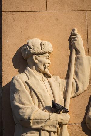 Moscow, Russia - July 21, 2018 - statue of Kazakh shepherd on a wall of a pavillion in VDNKh exibition park Redakční