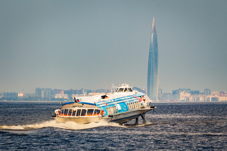 SAINT-PETERSBURG, RUSSIA, July 24, 2018: high speed The Peterhof Express hydrofoil boat, Skyscraper Lahta center on the shore of the Gulf of Finland in the background