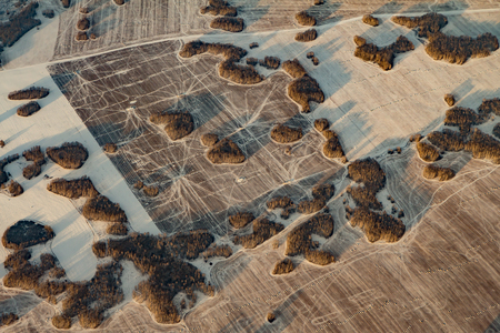 Aerial view of snow covered fields criss-crossed by roads and paths; Omsk region, Russia Reklamní fotografie