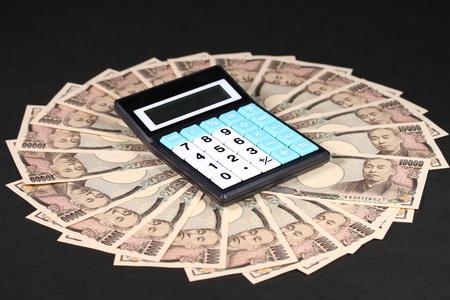 Ten thousand japanese yen bills and calculator