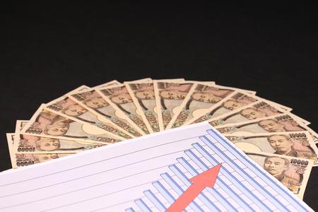 Ten thousand japanese yen bills and graph