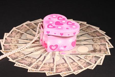 Ten thousand japanese yen bills and jewelry box Stock Photo