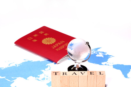 passport and miniature globe