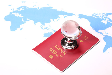 Map and passport and miniature globe