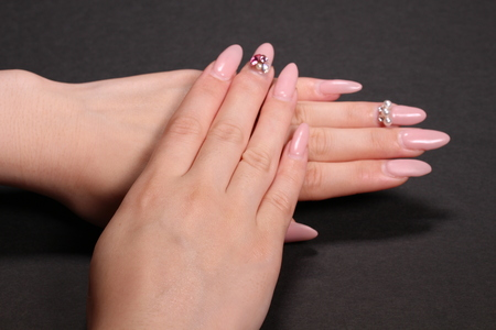 Beautiful womans fingers with pink nail polish