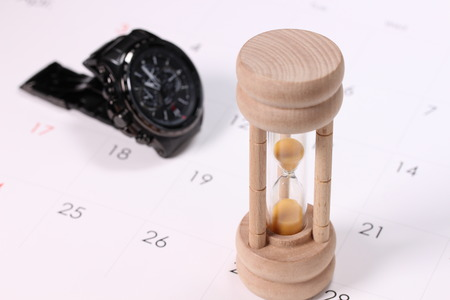 Calendar and watch and hourglass