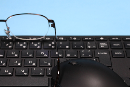 computer keyboard and mouse and glasses.letter is japanese abc. Stock Photo
