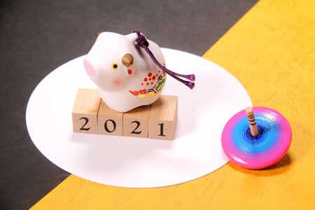 New Year's image, ox figurine and wooden top