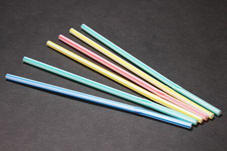 Colorful plastic straw on black background Reklamní fotografie