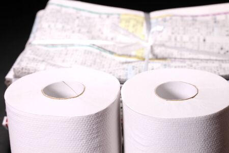 Toilet paper and old newspapers