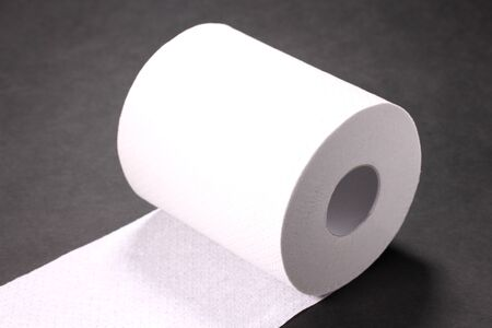 Toilet paper on black background