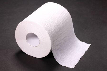 Toilet paper on black background