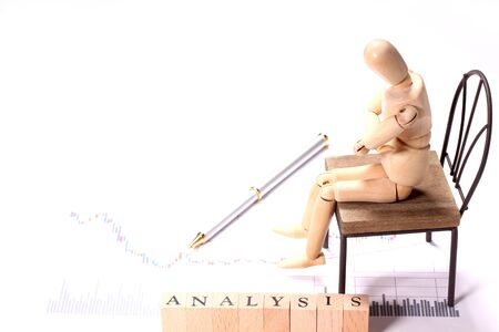 Analytical image, graph and wooden doll