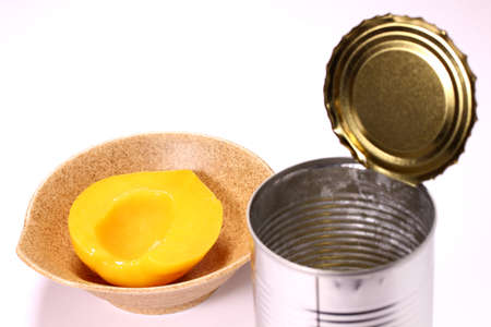 Canned yellow peach and empty can