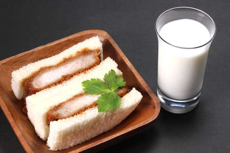 pork cutlet sandwich and glass of milk