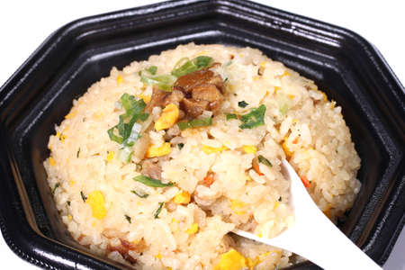 Chinese fried rice on a plate with spoon