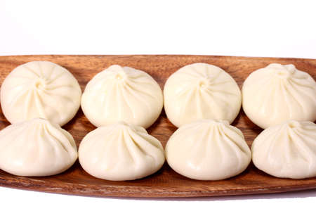 Chinese soup dumplings on a plate Imagens