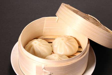 Chinese steamed soup dumplings in a basket