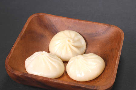 Chinese steamed soup dumplings   on a plate