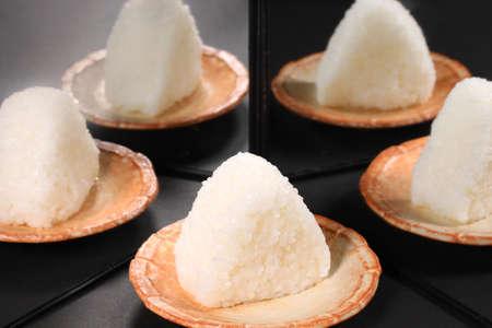 Onigiri, Japanese rice ball reflecting in the mirror