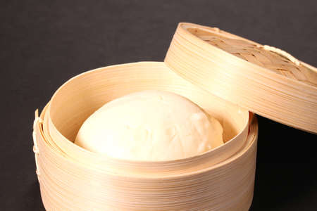 Chinese steamed pork bun in a steamer Imagens