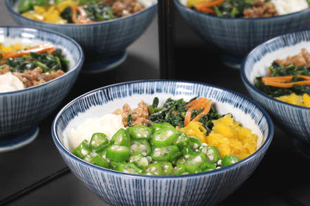 Japanese style healthy rice ,Okra yam natto bowl reflecting in the mirror