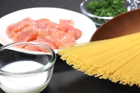 Ingredients for tarako spaghetti on black background
