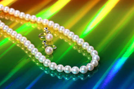 Pearl Necklace and earrings on  colorful background