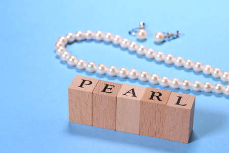 Pearl Necklace and earrings and letters of  PEARL