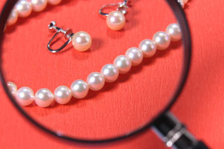 Pear Necklace and Earrings and  magnifying glass