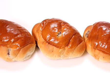 Bread Roll with raisins on white background