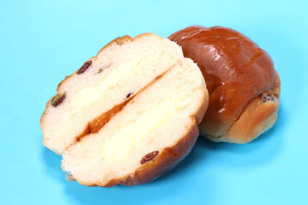 Bread Roll with raisins and margarine