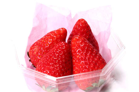 Fresh strawberries in a pack  on white background Zdjęcie Seryjne