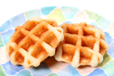 Waffle on a plate on white background Zdjęcie Seryjne