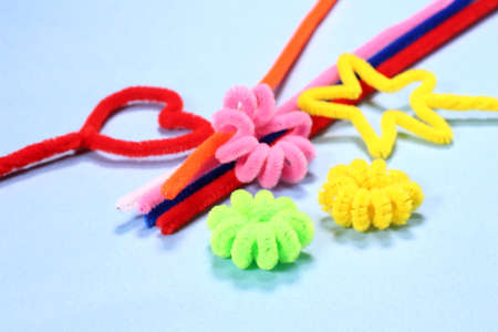 pipe cleaners on blue background