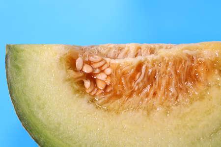 Cut melon on blue background