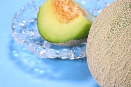 Cut melon and whole melon Banco de Imagens